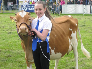 Abi Marshall with her winning heifer in Milk.
